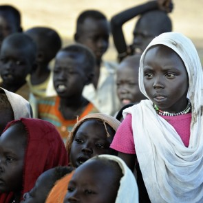 A girl in a school class in the Gendrassa refugee camp in South Sudan's Upper Nile State. More than 110,000 refugees were living in four camps in Maban County in October 2012, but officials expected more would arrive once the rainy season ended and people could cross rivers that block the routes from Sudan's Blue Nile area, where Sudanese military has been bombing civilian populations as part of its response to a local insurgency. Conditions in the camps are often grim, with outbreaks of diseases such as Hepatitis E.  Photo Paul Jeffrey/Lutheran World Federation.